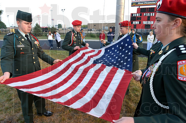 Flag raising: Terre Haute South Vigo Cadets prepare to raise the Flag during Sunday's 911 Rememberance event. The cadets include Robert Beckner, George Burgess, Caleb Favre, Heather Booker and jamie Schumaker.
