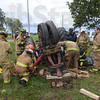 Tribune-Star/Rachel Keyes<br /> Rescue: Local fire departments tryto rescue a victim from who is trapped under a tractor as part of a Purdue-led farm accident rescue training event at the vigo county fair grounds Sunday.