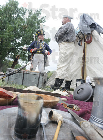 Tribune-Star/Rachel Keyes<br /> War rations: War of 1812 reenactors Carl Dougherty and Frank Butwin stand at the entrance of a tent at the 200th anniversary of the building of Fort Harrison.