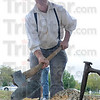 Tribune-Star/Rachel Keyes<br /> Hewing: Keith Ruble hews a log for a cabin that will be built at St. Mary of the Woods college while participating in the 200th anniversary of the building of Fort Harrison.