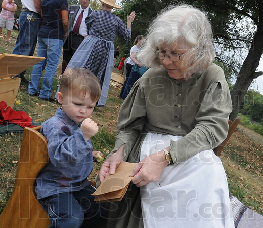 Tribune-Star/Rachel Keyes<br /> Book learning: Max Elliot Hummel (left) creates a book with his grandmother Madonna Hummel (right) as part of the 200th anniversary of the building of Fort Harrison.