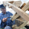 Tribune-Star/Rachel Keyes<br /> Shaping wood: Craig Hummel shapes the legs of a chair Sunday at the Landing as part of the 200th anniversary of the building of Fort Harrison.