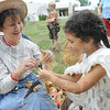 Tribune-Star/Rachel Keyes<br /> Corn doll: Peggy Apgar (left) and Olivia Hummel (right) make a doll out of corn husks.