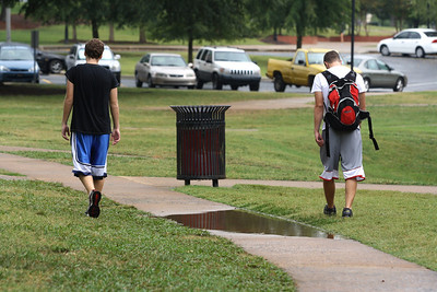 "Students had to ""share the grass"" as the puddles took over the sidewalks in some areas."