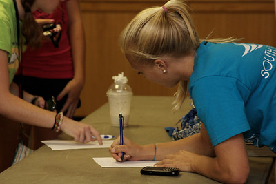 Student, Blaire Teeters, signs up for Prison Fellowship training after attended the interest meeting.