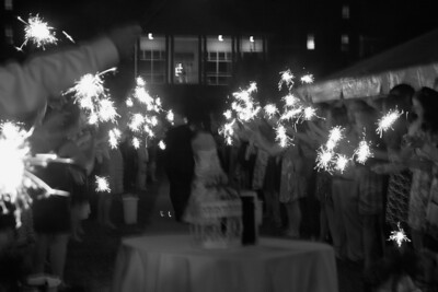 As the couple left, friends and family celebrated by waving sparklers.