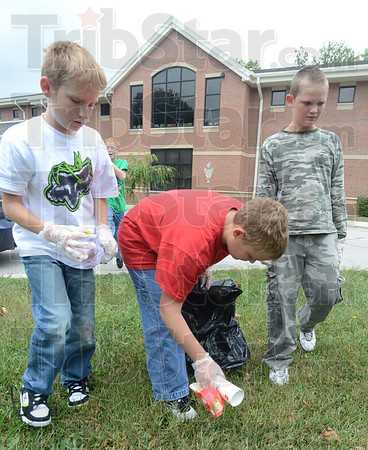 Tribune-Star/Jim Avelis<br /> Picking up: Sugar Creek Consolidated Elementary School fifth graders Aiden Mundy, Christopher Fritz and John Keller police the grounds, picking up litter and pulling weeds. Teresa Stuckey's class did service projects on Friday.