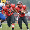 Leading: South #54 Brandon Russell-Cherry lead blocks for #28 Tyler Evans during game action against Carmel Friday night.