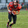 Looking: South's #15, Jacob Johnson looks for running room on a kick return against Carmel Friday night.