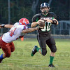 Escape: West Vigo quarterback #30 Cody Thornton escapes the grasp of Linton's #54 Ethan Lannan during game action Friday night.