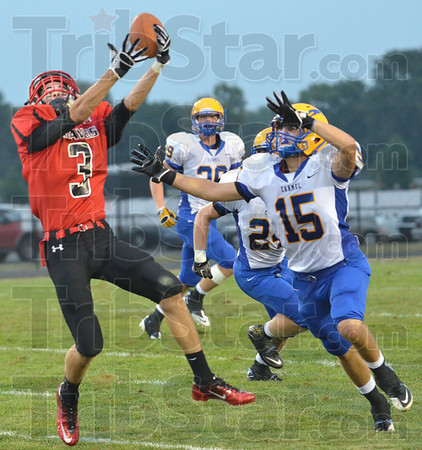 Not: South's #3, Tyler Seibert gets his hands on a high throw but has it jarred loose by Carmel defender #15 Cameron Cruz during game action Friday night.