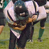 Tribune-Star/Jim Avelis<br /> Group hug: South Vermillion quarterback Jordan Branz is engulfed by West Vigo's Zach Ewan(76) in late first half action on the Viking's field.