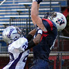 Tribune-Star/Jim Avelis<br /> Flying high: Calvin Blank goes high for a Terre Haute North touchdown in first quarter action. Defending on the play is Ben Davis defensive back David Walls.