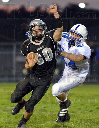 Escape: Northview quarterback Damoy Hyatt escapes the grasp of Chatard's #44, Andy McGinnis during first half action Friday night.