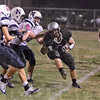 Tribune-Star/Jim Avelis<br /> Toe the line: Northview running back Jessie Miller is shoved out of bounds by a host of Terre Haute North players.