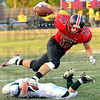 Balance: South's #17, Nic Keller leaps over a Vincennes tackler during first half action Friday night.