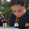Tribune-Star/Jim Avelis<br /> Tusk, tusk: Hamilton Center employee Marni Mowrer  competes in the Walrus Marshmallow Maneuver, moving the marshmallows from one plate to another with swizzle sticks. She and co-workers were taking part in the annual Corporate Olympics sponsored by First Financial bank.