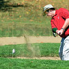 Bunker buster: Jim Homburg hits from the sand on the 11th hole of Hulman Links Saturday morning.