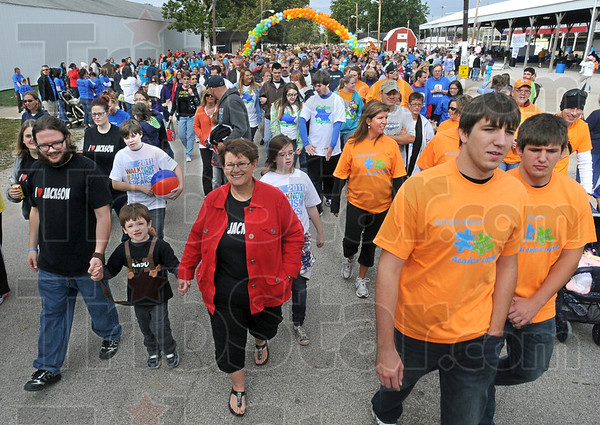 Thousands: A huge crowd starts the Walk Now For Autism Speaks event at the Vigo County Fairgrounds Saturday morning.