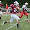 Tribune-Star/Jim Avelis<br /> Breaking away: Kyle Kovach heads to the end zone for the first Rose-Hulman touchdown Saturday. Teammate Jordan Nielson(84) escorts him while Hanover's Sam Louis tries in vain to  catch him.