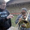 Tribune-Star/Jim Avelis<br /> Like this: Indiana State University senior Ben Schepper helps Anyea' Basley get some sound from a trombone at the Vigo County's Learning Day.