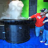 Tribune-Star/Jim Avelis<br /> Poof: Jason Beai shows his son Braydon how to work the cloud machine at the Terre Haute Children's Museum Saturday morning.