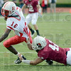 Tribune-Star/Jim Avelis<br /> Slow down: Hanover quarterback Dexter Britt is hauled down for a loss by Rose-Hulman's Ben Parker