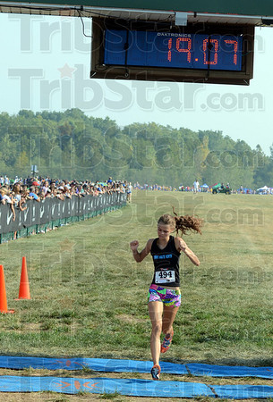 Tribune-Star/Jim Avelis<br /> Not even close: Chanli Mundy crosses the finish line with her nearest competitor just visible behind her.