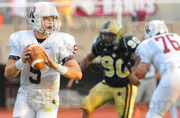 Tribune-Star/Rachel Keyes<br /> Hungry eyes: Rose Hulman's quarter back Mitch Snyder looks down field for a receiver Saturday night.