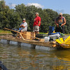 Tribune-Star/Jim Avelis<br /> Break time: Rafters Jim Foster, Dan Renaly and John Cornell watch fishermen just down river from their raft. The trio caught some fish on their way down river, but none they cared to eat.