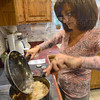 Tribune-Star/Jim Avelis<br /> One pot: To stretch their alloted food money, Claudia Tanoos prepared a rice and lentils meal Wednesday evening. Sauteed onions and gsalt and pepper made up the seasoning.