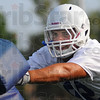 Tribune-Star/Jim Avelis<br /> Back in blue: Ben Obaseki goes through drill during the first day of practice for teh Indiana State University football team.
