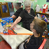 Tribune-Star/Jim Avelis<br /> Laugh and learn: Carson Goodman laughs while working through his speech therapy class with Elaine Good at Union Hospital's Pediatric Therapy center.
