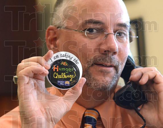 Tribune-Star/Jim Avelis<br /> Pinned: Tribune-Star publisher B.J. Riley displays his hunger challenge pin while at work Monday.