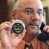 Tribune-Star/Jim Avelis<br /> Pinned: Tribune-Star publisher B.J. Riley displays his hunger challenge pin while at work Monday.