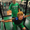 Tribune-Star/Jim Avelis<br /> Helping out: Jacob Creasey spots for his brother Danny in Monday's session in the West Vigo weight room.