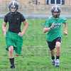 Tribune-Star/Jim Avelis<br /> Paired up: Danny and Jacob Creasey run sprints at practice Monday after school.