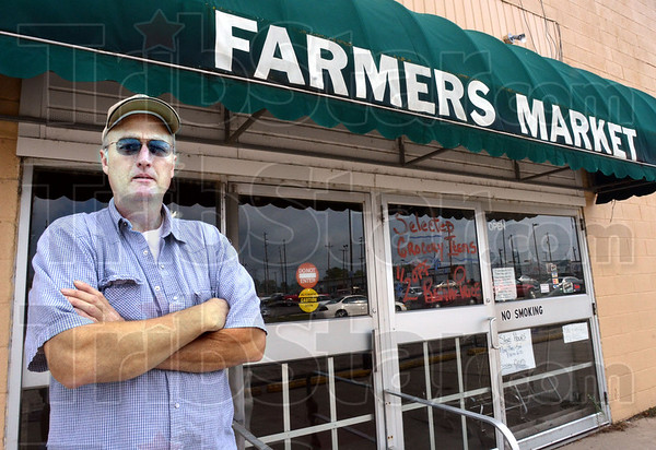 Leaving?: Kevin Adams operates the Farmers Market and will be forced to move soon.