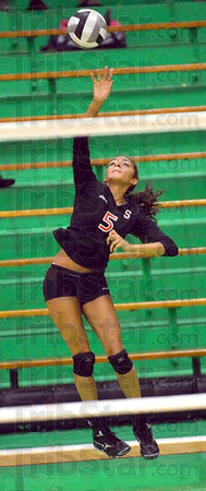 Serve: South's #5, Ashley Bazier serves during the first game of Monday's match at West Vigo.