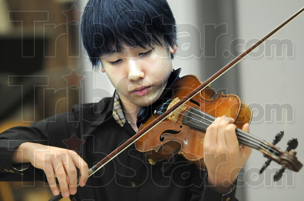 Virtuoso: Stephen Kim plays for a group of orchestra students at Terre Haute South Monday afternoon.