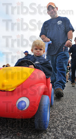 Tribune-Star/Jim Avelis<br /> On the go: Alexandria Tingley rides while her dad Tom walks in the annual Labor Day parade. Tingley, a member of Laborers LOcal 204, was part of a parade that boasted about 3,000 walkers.