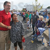 Tribune-Star/Jim Avelis<br /> Picture this: Terre Haute moyor Duke Bennett poses for a photograph with Crystal Reynolds as he walked in the Labor Day parade.
