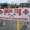 """Tribune-Star/Jim Avelis<br /> Protectors: The theme for this year's Labor Day parade was """"Honoring those who Labor, Protect and Serve"""". Here several of Terre Haute's firefighters take part in the annual event."""