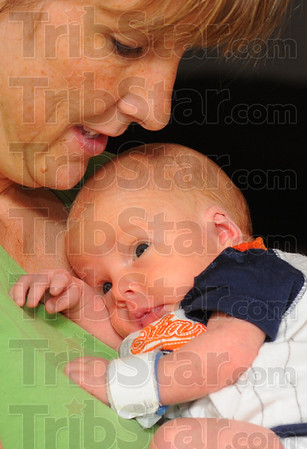 Tribune-Star/Jim Avelis<br /> Look-a-likes: Sue Ann Scott holds Brady. She said she'll leave their hospital ID bracelets on for now until she can better tell them apart.