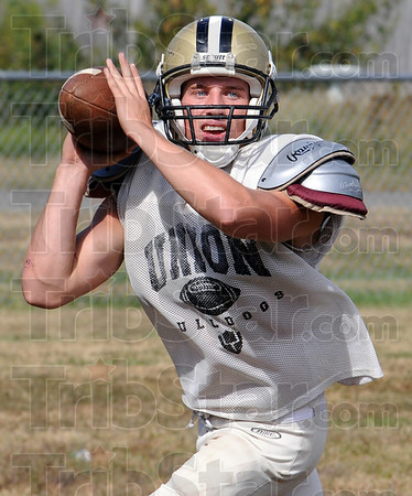 Lookin': Union quarterback Sterling Langley looks for a receiver during Wednesday's practice at the school.