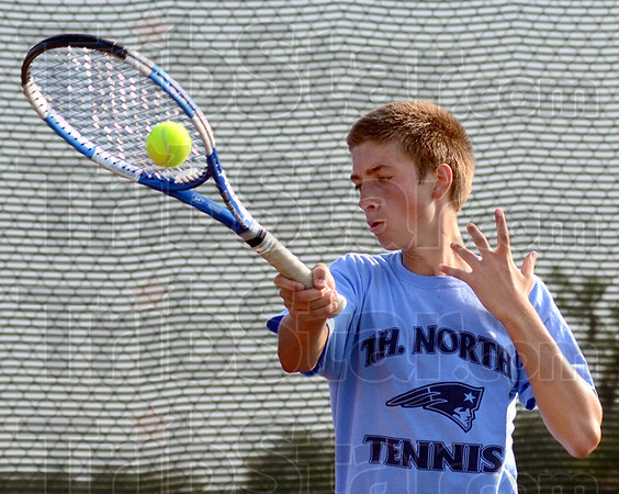 Tribune-Star/Jim Avelis<br /> Second court: Tate Egan plays #2 singles for Terre Haute North.