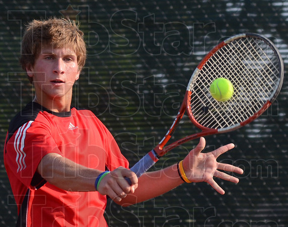 Tribune-Star/Jim Avelis<br /> Return game: Terre Haute South's Austin Foster returns the ball to Chris Holcomb in their #1 singles match.