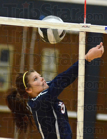 Tribune-Star/Jim Avelis Fair ball: Mandee Eberle bumps the ball back ove the net from the side.
