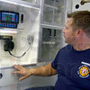 Tribune-Star/Jim Avelis<br /> Upgrade: Terre Haute fire department paramedic Jeff Mson looks over the two-way radio and patient compartment monitor in one of the new ambulances added to the city's fleet.
