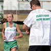 Coach: St. Patrick's cross country coach Justin Kunz encourages his runner Lindsay Welker as she runs a cross country course near Sarah Scott Middle School Tuesday.